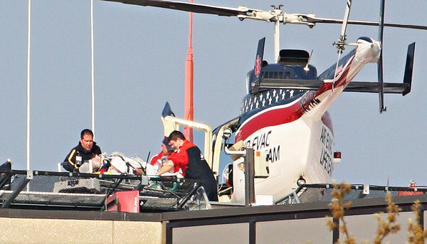AirCare medic Toby Hancock assisting Air Evac Lifeteam crew with patient.