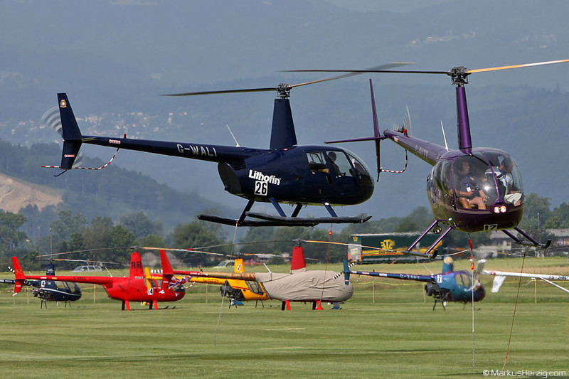 G-RUZZ and G-WALI  R44 Raven II @ Grenchen Switzerland 25Jun10 - OSM 2010
