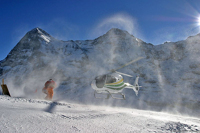 HB-ZCA EC120B Rhein-Helikopter @ Lauberhorn Switzerland 14Jan05 - Background: Eiger and Mönch