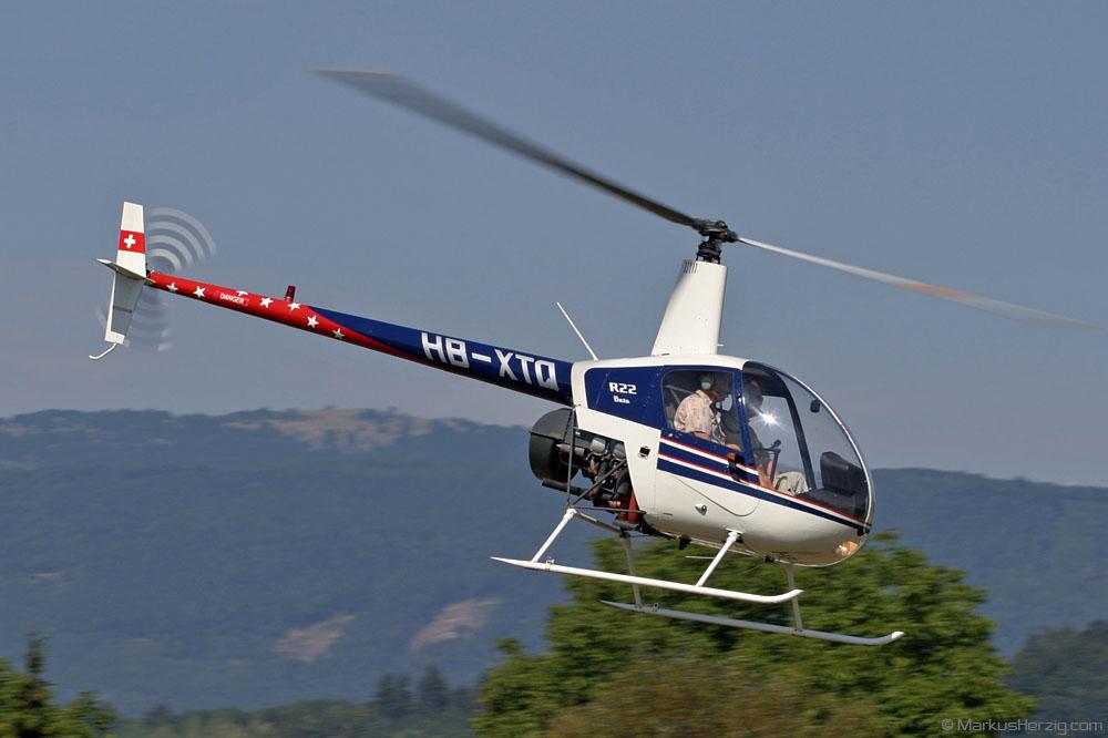 HB-XTQ Robinson R22 Airport Helicopter Basel @ Biel-Kappelen Switzerland 24Aug03