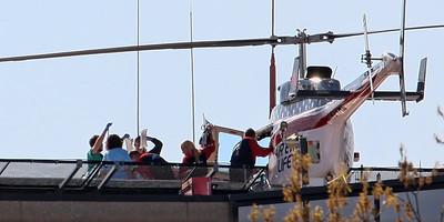Air Evac 59 Lifeteam on the University of Iowa hospital helipad with a critical care patient.  Pilot Tom Bushek, medic Aaron, and nurse Margaret.
