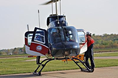 Air Evac 59 Lifeteam paramedic Aaron Feagain waves.    Aaron gave me an Air Evac Lifeteam pin which I will cherish always.  Thank you Aaron :)