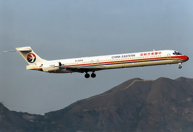 China Eastern Airlines McDonnell Douglas MD-90-30  	Hong Kong - Kai Tak Intl. (HKG / VHHH) (closed) China - Hong Kong, February 1998 Reg: B-2258  Cn: 53584/2203