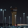Crescent moon accenting the old IAH tower