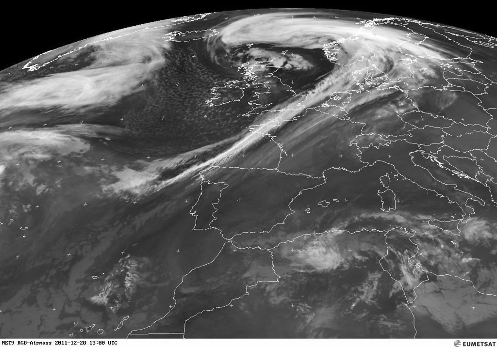 Meteosat satellite photo of 28 dec 2011. A real low pressure system, anticlockwise, above Scotland. The long coldfront trailing, just reaches Spain.<br /> <br /> Copyright 2011 EUMETSAT