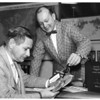 Tom Hancock and Bill Prescott going over some of Jeppesen & Company's products.  Captain Jepp hired Bill Prescott back in 1954 where he worked for fourteen (14) years and was the Senior Vice President of Sales and Marketing and an officer of the company.