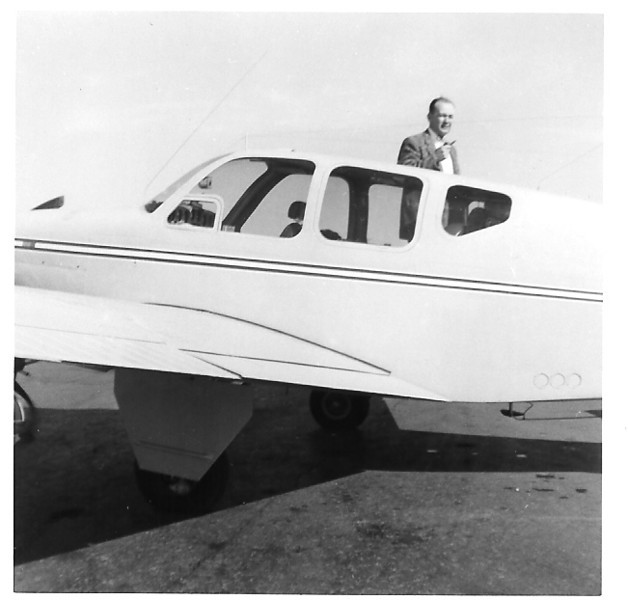 Bill Prescott and Jeppesen & Company's first corporate aircraft, an F35 Model Beechcraft Bonanza.  Bill Prescott flew the Bonanza around the country for sales visits to FBOs (Fixed Base Operators) located at airports.