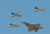 Heritage flight: Raptor and 3 Mustangs.