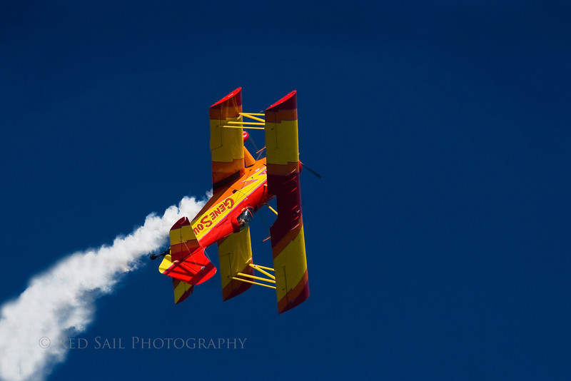 Gene Saucy Airshows. Pilot Gene Saucy flies the Showcat, a Grumman built bi-plane, over Jacksonville Beach, Florida.