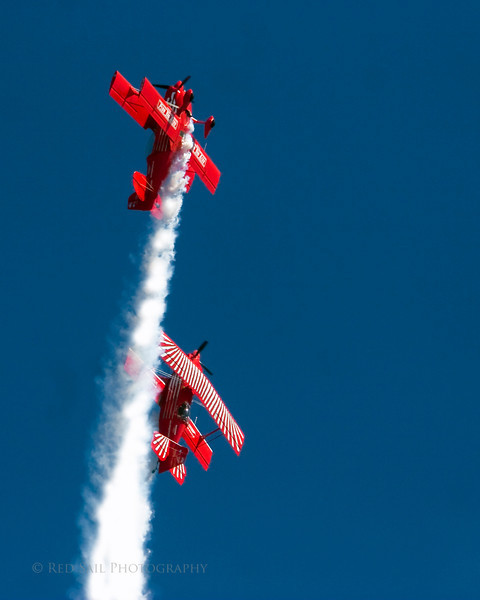 Red Eagle Air Sports. The Red Eagle team pilots, Dan McClung and Buck Roetman perform low level precision formation and solo aerobatics at the Sea & Sky Spectacular at Jacksonville Beach, Florida.