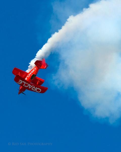 Team Oracle. Sean Tucker flying his one-of-a-kind aerobatic dream machine, the Challenger II bi-plane.