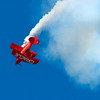 Team Oracle. Sean Tucker flying his one-of-a-kind aerobatic dream machine, the Challenger II bi-plane.