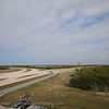 "View from the observation gantry looking out towards the two launch pads.  On the right is 39A and on the left further back is the remnants of 39B.  The wide gravel roads that you see are the ""roads"" used by the crawler transport."