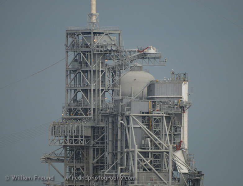 A close up of Pad 39A.  Discovery had just been rollerd back into the VAB to fix the stringer problems that were found while on the Pad.  On the lower left you can see 8 cables that go from the tower to the lower left which are part of the emergency evacuation system that the astronauts can use if there are any problems while on the pad