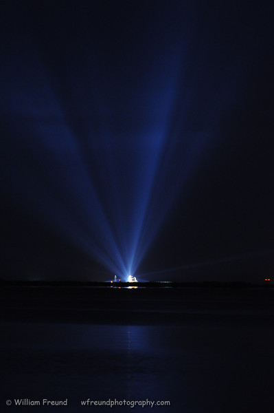 Shot of Endeavour on launch pad 39A from across the Indian river the night before its final launch into orbit.