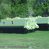 These are the armored personnel carriers (APC) that the crew would use if they ever have an emergency and have to evacuate the shuttle.  They would evacuate through the zip line system that comes out of the launch pad and it drops them off just behind these vehicles so the crew can get in, close the ramp, and have a somewhat safe way of evacuating the area.