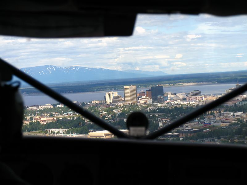 Downtown Anchorage skyline on approach to Merrill Field for landing.
