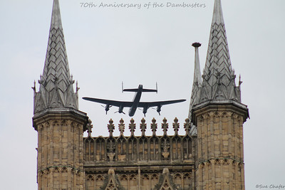 The Lancaster from the Battle of Britain Memorial Flight is caught between the towers of Lincoln Cathedral during the Dambuster's 70th Anniversary flypast.