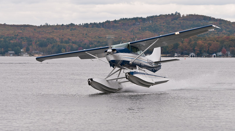 Lakes Region Seaplane Services Cessna 206 on one float. Paugus Bay on Lake Winnipesaukee