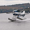 Lakes Region Seaplane Services Cessna 206 on one float. Paugus Bay on Lake Winnipesaukee
