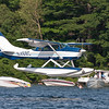 Lakes Region Seaplane Services landing on Paugus Bay.