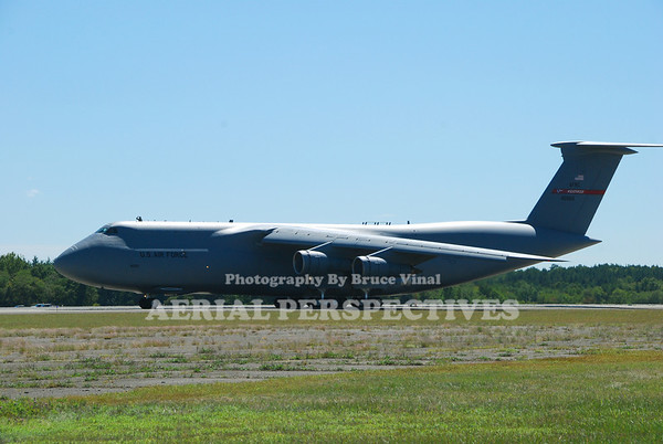 "Lockheed C-5B Galaxy -Note the crewman waving from the ""sunroof"""