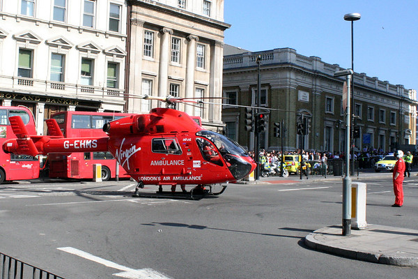 2 June 2011<br /> London Air Ambulance just after landing. Crew member watching as the rotors slow down.