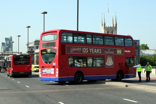 2 June 2011<br /> Bus being turned on London Bridge. It grounded, and eventually reversed across the bridge.