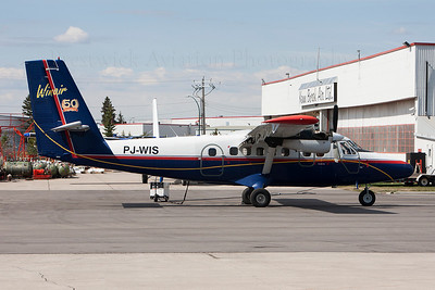 PJ-WIS. De Havilland Canada DHC-6-300 Twin Otter. Win Air. Calgary. 130514.  Long way from home, receiving maintenance at Ken Borek Air.