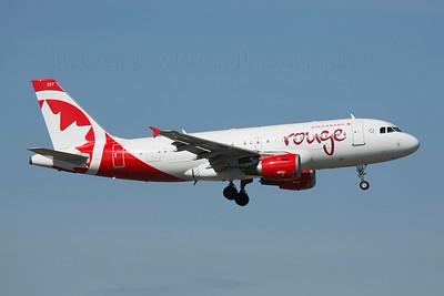 C-FYJH. Airbus A319-114. Air Canada Rouge. Calgary. 130514.