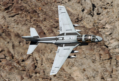 USA - Navy Grumman EA-6B Prowler (G-128)  Rainbow Canyon  USA - California, October 30, 2012 Reg: 159909 / Code: XE-536 / Cn: MP-56 Wow, a Prowler on the prowl. Vampire 51 is buzzing fast and low through the narrow Canyon, it made my day! Unit is VX-9 Vampires out of NAS China Lake. The guy on the right hand seat seems to have spotted the photographer and the seat behind him is empty.