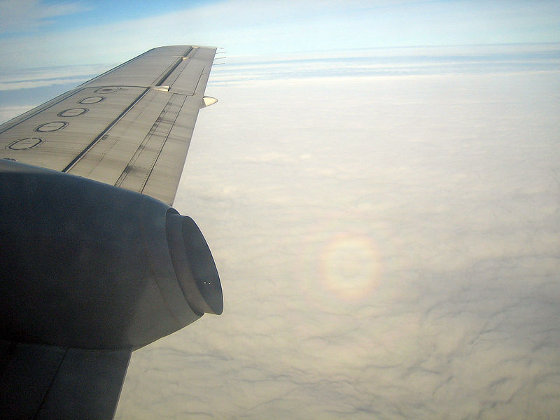 The rainbow contains a small shadow of our aircraft, which is not really visible here