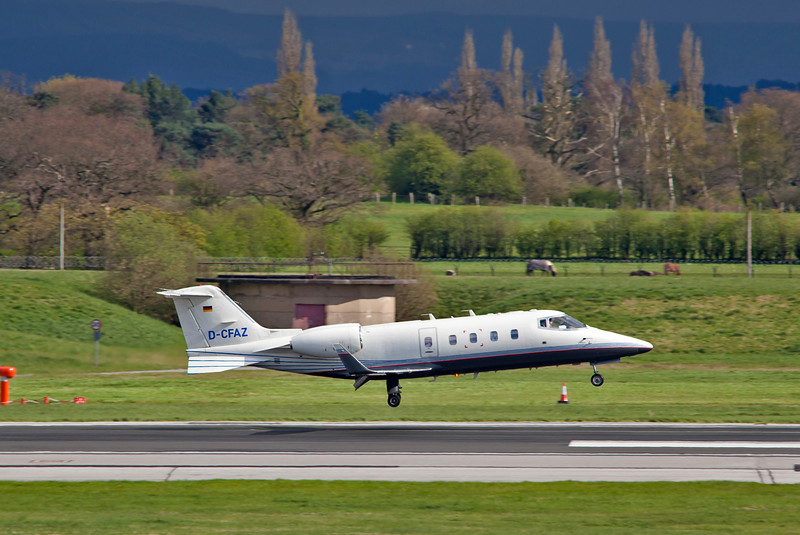 This German Learjet about to touchdown on runway 23R.