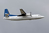 PH-JXK Fokker 50 departing off  23R into a leaden sky.