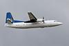 PH-JXK Fokker 50 departing off  23R into a leaden sky.