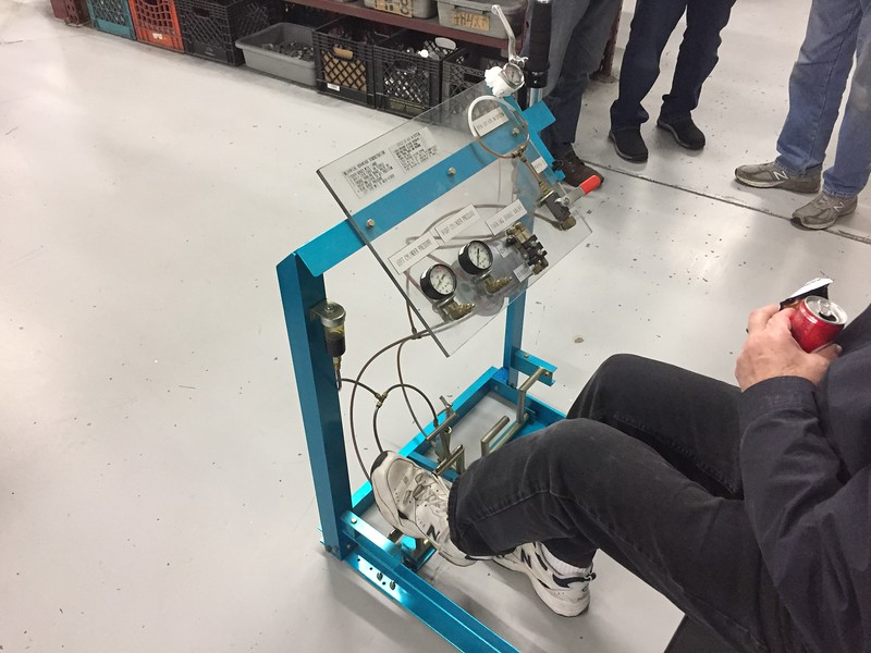 They pulled out their demonstration system and have a nice way to show customers how the geometry of the brake pedals has a big impact on the amount of PSI you can generate from the pedal to the brake cylinders. You can also see how the parking brakes work, and introduce a line with air in the system. Any air in the lines will greatly reduce the amount of pressure the brakes will receive and will give the pedal a very mushy feel.