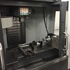 This CNC milling machine has 3 different stations so that multiple parts can be put in and finished in one step.