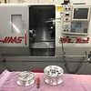 The cast wheels are then machined on these Haas CNC machines. They had a number of different CNC machines in the factory all set up to handle the milling and turning. This is a CNC lathe.