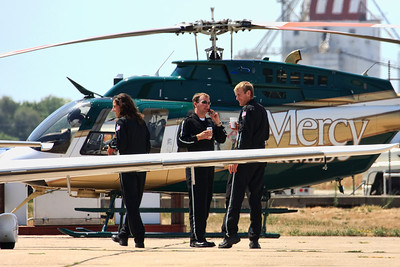 Mercy Air Med pilot (center) and medical crew at the Iowa City Municipal Airport