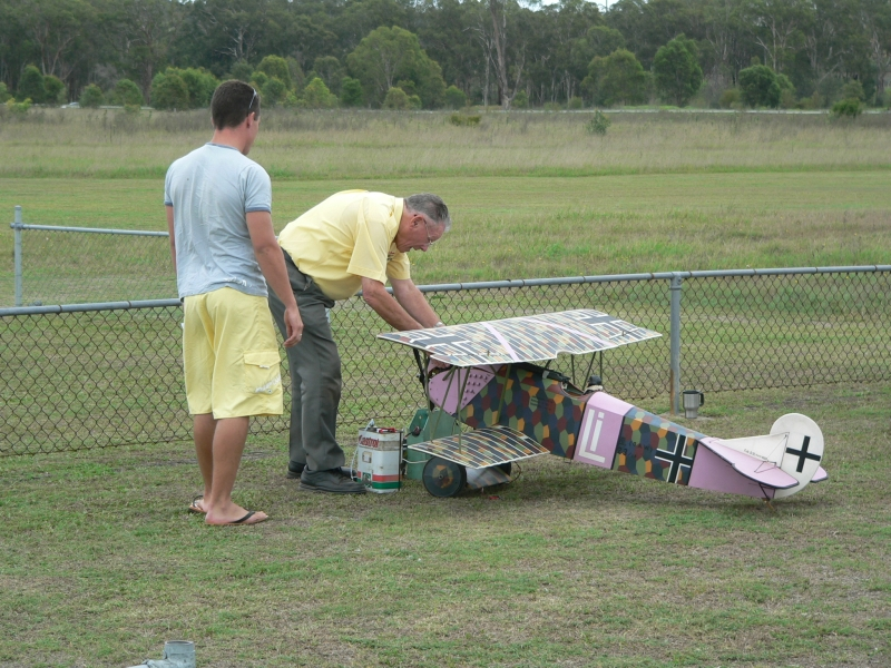 Anthony Ogle watches as Ken Cowdroy prepares his Fokker D7