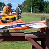 Members of the Middlesex County R/C Flyers Club work on their remote controlled planes before flight at the Vietnam Veterans Park in Billerica on Sunday afternoon. (SUN/Ashley Green)