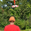 Neil Cumbie, of Lowell,  hangs his remote controlled plane at a vertical hover at Vietnam Veterans Park in Billerica on Sunday afternoon. Cumbie is part of the Middlesex County R/C Flyers Club. (SUN/Ashley Green)