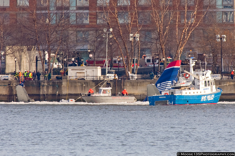Police, Fire, and Coast Guard vessels work to break up the ice.