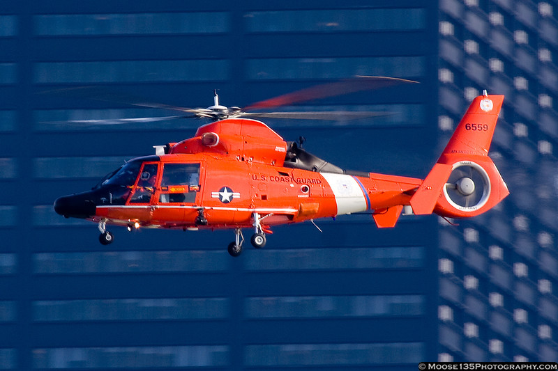 Coast Guard helicopter patrols the river.