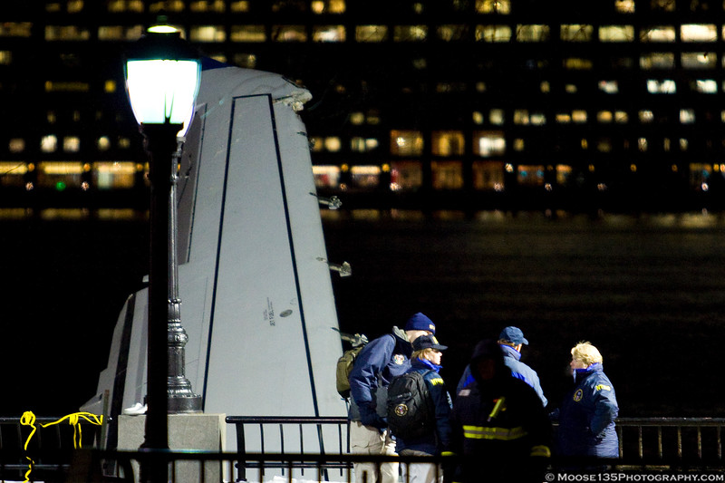 Investigators meeting near the aircraft in Battery Park City.