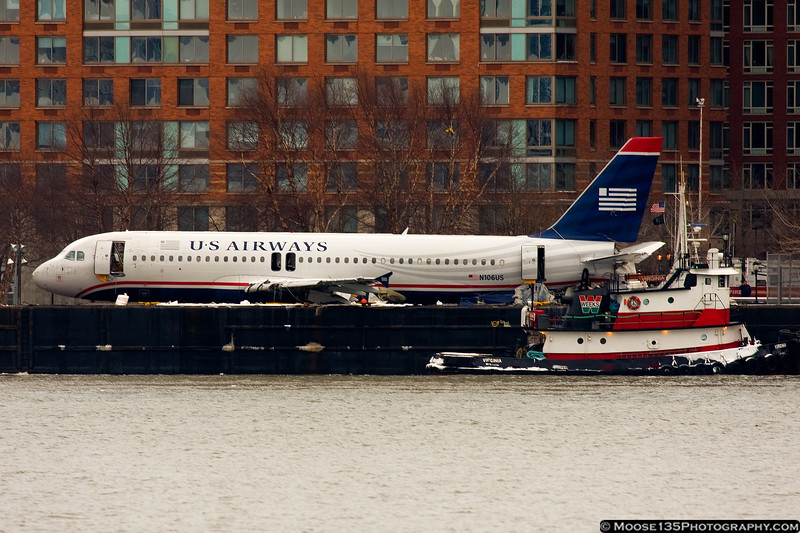 N106US on a barge, after being lifted out of the Hudson River.