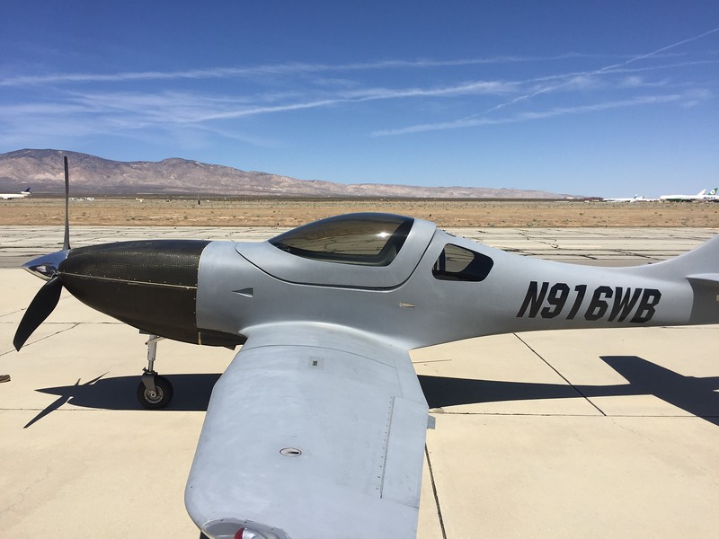 Lancair Legacy. Nice carbon fiber cowling, but really needs some TLC on the interior and exterior finishes.