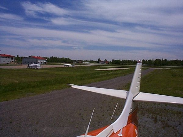 This is a view of the airport in LaChute Canada where I took Juliet to be repainted. You can see the beautiful orange oem paint as well as the new flush beacon kit and the NACA duct. The paint shop (Noilco) did a good job but is since kaput.
