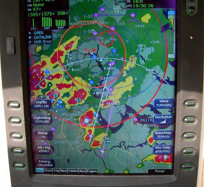 Arriving in the DC area back from Oshkosh, WI late Aug 2007. Lots of storms to negotiate as we headed to RWY 6 at Potomac Airfield (purple line).  But the red blob at IRONS intersection changed to yellow and we went on thru with no problems.