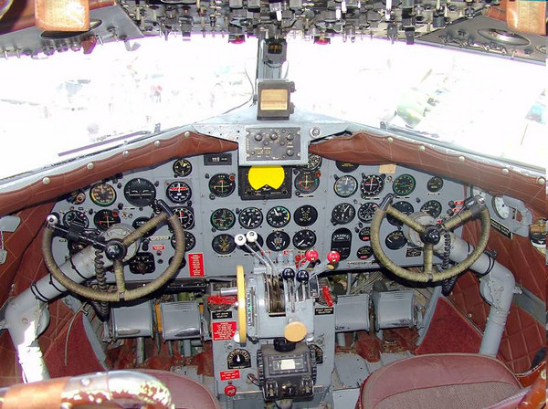 """By comparison, here is the cockpit of a DC3. Besides the old """"steam gauges"""", look at all the knobs and buttons overhead."""